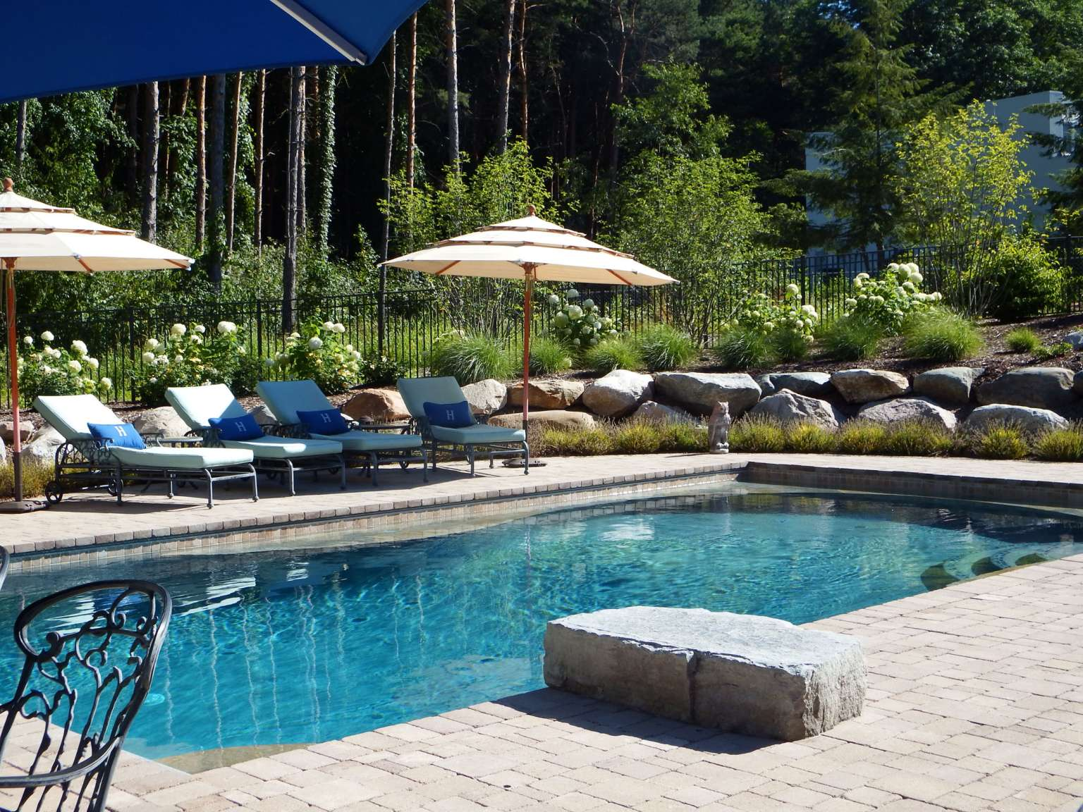 Cascade Pool, natural stone walls, and firepit
