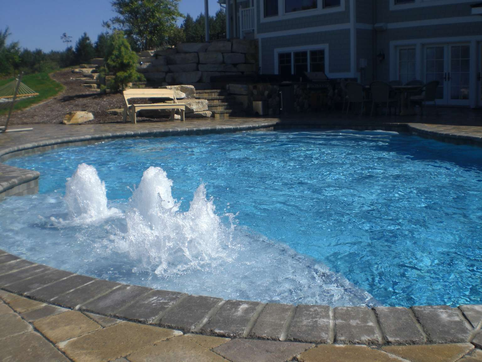 Ada Free Form Swimming Pool And Outdoor Kitchen